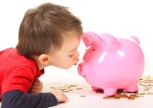 Kissing a piggy shaped bank