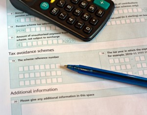 Tax forms, calculator and pen