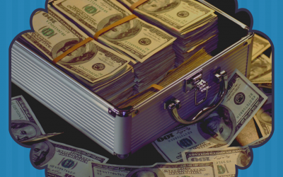 Stacks of money in and around a metal suitcase